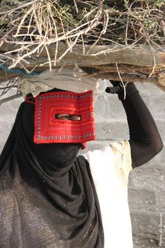 A woman with red mask (BORGHA) in Hormozgan,Iran...