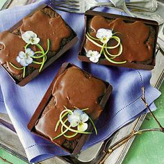 Chocolate Zucchini Cakes | Spiked with a triple hit of chocolate (we're talking intensely rich sour cream-fudge frosting here), these are definitely not your garden-variety zucchini cakes. | SouthernLiving.com