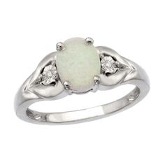 l. Fashioned in fine sterling silver, this ring features an 8.0 x 6.0mm oval-shaped, lab-created luminous white opal center stone. Two leaf-shaped accents, each adorned with a shimmering diamond accent, flank this gem