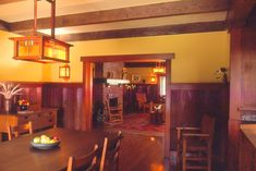 The long neglected Arts and Crafts (1910) Mead house by Louis B. Easton was still basically intact.  We restored every surface inside and out. Restored dining room includes new redwood and art glass light fixtures we designed.  Combined with other deep colors they help create a serene atmosphere.