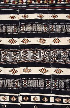 Africa | Detail from a blanket from the Fulani people | Woven of white sheep wool on a horizontal strip loom, they are made of four to six panels sewn selvedge to selvedge. Each strip has additional decoration applied with supplementary weft | ca. early 20th century