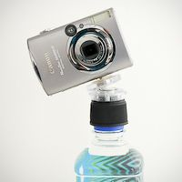 This website has some of the neatest photography-related devices. Bottlecap tripod. iPhone filters... just check it out.