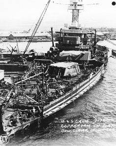 California being refloated after removal of her main battery.  1942