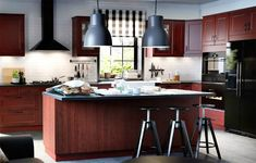 Kitchens with black appliances.
