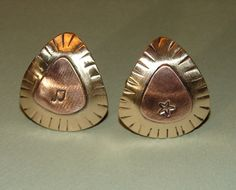 Guitar pick cuff links rocking out in copper on bronze. $30.00, via Etsy.