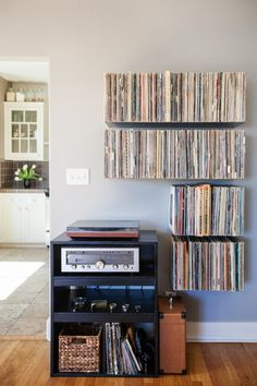 Floating record shelves by Mike Zimmerer of Zimm Metalworks via @Design*Sponge records shelves, living rooms, vinyl shelves, floating shelves, rangement vinyl, old records, records decoration, floating record shelves, record collection