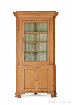 """Realized Price: $3840 Pennsylvania painted pine and poplar two-part corner cupboard, ca. 1810, retaining an old salmon surface, 89 1/2"""" h...."""
