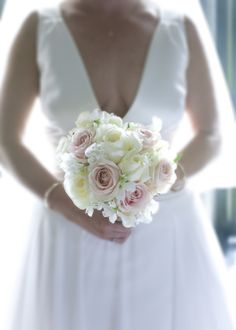 pale white and pink wedding bouquet via weddingsonline.ie