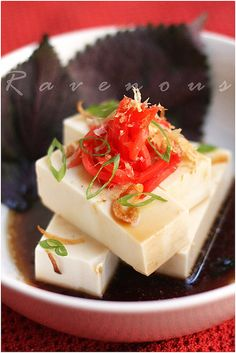 Cold Tofu with Ponzu Sauce – Hiyayakko Tofu  Printable Recipe (serves 2)    1 package of cold soft tofu (we prefer silken tofu but you can use cotton strained as well)  1 package of bonito flakes  1 package of pickled ginger  1 tbs thinly sliced scallions  Perilla/Shiso leaves  Optional: fried shallots, roasted sesame, sliced jalepeno