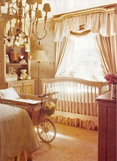 love the shades of gold, cream and pink in this nursery....and the wallpaper