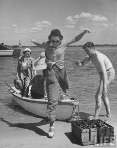 From a Shared Board of Story Ideas - Alfred Eisenstaedt.    The boat ride was over at last. Now the real fun could begin.  ;-)