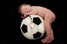 Baby on a soccer ball