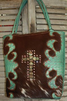 KurtMen Designs Large Brown Hair on Hide with Turquoise and Brown Hand Tooled Leather with Large Turqouise Cross www.gugonline.com $479.95