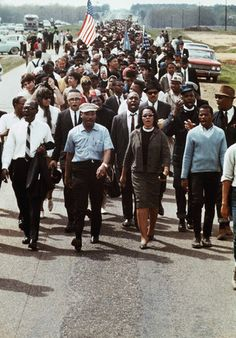Dr. Martin Luther King, Jr., Coretta Scott King, and others lead the five-day march to Montgomery, Alabama, March 25, 1965.