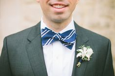 white boutonniere - photo by Steven Michael - http://ruffledblog.com/nautical-striped-kansas-wedding/