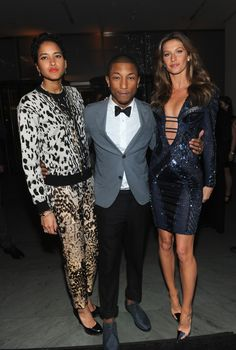 Lucky man. Pharrell Williams attends WSJ. Magazine's Innovator of the Year Awards with wife Helen Lasichanh and Gisele Bündchen on his arms on Nov. 6 in New York