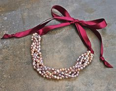 Pink Pearl Ribbon Necklace.  Would be adorable with black ribbon and white pearls! I <3 fake pearls.