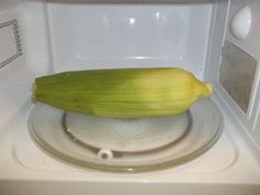How to never shuck corn again ~  Cook corn on the cob in microwave, Remove  using oven mitts, cut about 1 inch off the bottom, hold corn up from the opposite end and it will easily slide out completely clean... check it out, Im gonna try this!