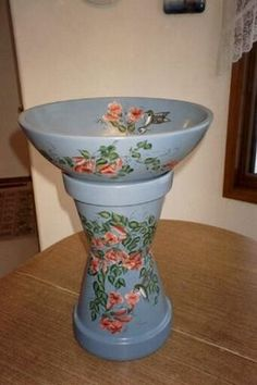 For sure will attempt one of these made of terra cotta pots... want one for the middle of my herb garden:)