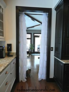 Hang Gypsy Ruffled curtains in your doorway. #privacy #saveenergy #shabbychic #ruffled