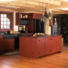 Primitive kitchen. I love the simplicity of this. open concept, red door, red kitchen, shades of red, countri kitchen, primit kitchen, new england homes, island, primitive kitchen