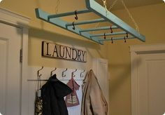 Use an old ladder to help dry and hang clean laundry.