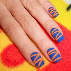 Orange and Blue Nails via The Sugar Cube