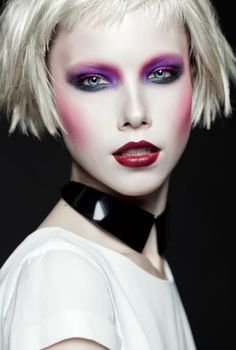 Purple green black eyes with red lips, white face platinum hair