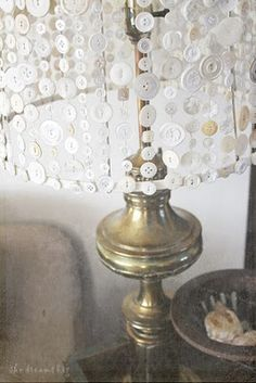 "Button lamp shade.    I like the look of the white buttons on wire, maybe for ""icicles"" to hang in the winter."