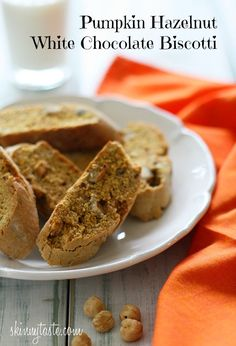 "Pumpkin Hazelnut White Chocolate Biscotti - Hazelnuts, white chocolate and pumpkin spices are the perfect combination for these crispy ""adult"" cookies."