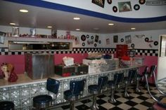 54 Diner Osage Beach, Missouri. One of the last times I went to the Ozarks on a trip with my family, we discovered the 54 Diner in Osage Beach. I thought it was so cool. It had the checkered floor, records on the wall and the waitresses even wore the poodle skirts.  It's one of my favorite memories from the lake. My younger brothers were amazed at the 54 Chevy front end that hung off the front of the building!