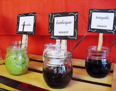 spreads in mason jars with clothespins for labels