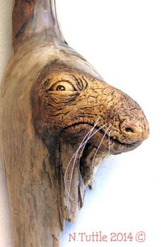 """""""A Wood Wart"""" 13 inches tall and 4 inches to the end of his snout. Carved Oregon driftwood with cat whiskers! This piece hangs showing off his cute profile. Signed and dated: N. Tuttle 9/11/14"""