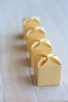 Metallic gold wedding favor boxes. Keywords: #goldweddings #metallicgoldweddingfavorboxes  #inspirationandideasforgoldweddingplanning #jevel #jevelweddingplanning Follow Us: www.jevelweddingplanning.com www.pinterest.com/jevelwedding/ www.facebook.com/jevelweddingplanning/ https://plus.google.com/u/0/105109573846210973606/ www.twitter.com/jevelwedding/