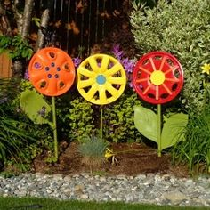 I couldn't resist adding these bright, bold Hubcap Flowers from The Weathered Door to my collection. These are the perfect garden art to instantly add color to a any landscape.