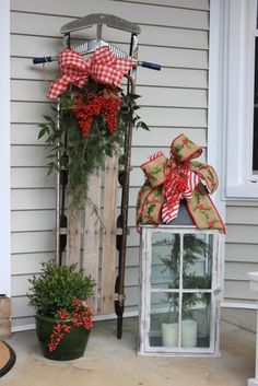 Outdoor Christmas Decorations - I see I'm not the only who decorates a sled on the porch for Christmas! =)
