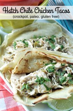 Crockpot Hatch Chile Chicken Tacos uses fresh roasted hatch chiles for a smokey kick of flavor paired with cumin, onions and fresh cilantro! Eat it in paleo tortillas or in a bowl over cauliflower rice!