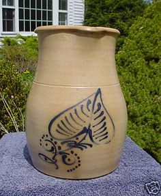Beautiful 1800s stoneware pitcher with blue cobalt ace of spades flower design!! 10 in tall. One fine line on one side of pour spout.