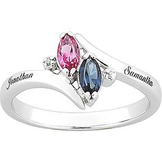 I have always wanted a ring like this with my birthstone and my hubby's. But I think I would love this with my boy's names and birthstone - ruby