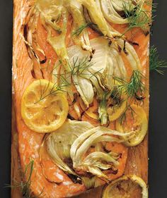 Plank-Grilled Salmon With Lemon and Fennel recipe: Sliced fennel and fresh fronds add a licorice-like sweetness while the lemon lends a citrusy brightness.