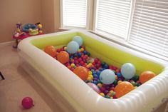 Ball pit using an inflatable pool for home - perfect use for the inflatable pool during the winter! Would be so fun at a birthday party!