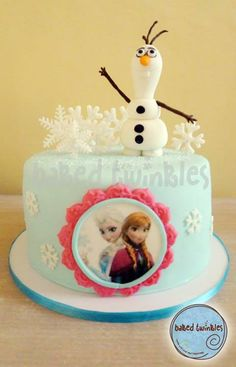 disney frozen themed celebration cake with Olaf made from homemade marshmallow fondant.  picture of Princess Elsa and Princess Anna printed on edible wafer sheet