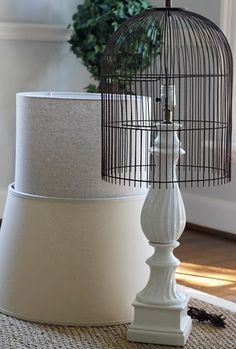 use a wire cloche or old bird cage as a lamp shade
