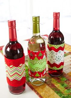 DIY: Create festive wine bottle wraps, perfect for gift-giving. Cute idea