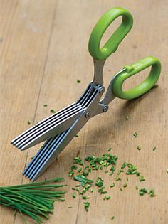 This is one of my most used kitchen doodads - Herb Scissors, with 5 parallel blades cut herbs quickly.