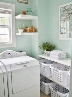 Organized Laundry Rooms - Laundry Room Design - Good Housekeeping organizer laundry, floating shelves, room colors, organ laundri, laundry rooms, paint colors, laundry baskets, laundri room, laundry room makeovers