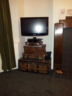 Trunk and suitcase tv stand.