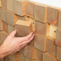 Cut blocks in different sizes to create a textured look for your wall.