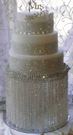 SALE SALE SALE Wedding Cake Stand With Crystals Chandelier Waterfall Iridescent Beads, is a spectacular complement to your crystal theme.. $99.00, via Etsy.