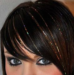 Adding tinsel to hair... huh, kinda cute - especially for like New Years Eve :)